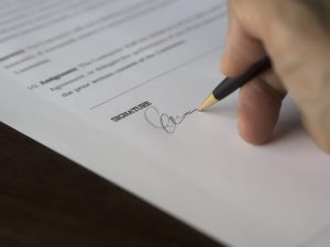A cosigner or guarantor can help a borrower get credit by pledging to be responsible for the debt in the event that the primary borrower cannot repay it.