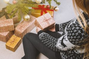You can limit your spending on holiday gifts by first estimating how much you are prepared to spend on gifts for each individual person on your list.